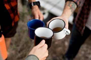 A group of campers drinking coffee